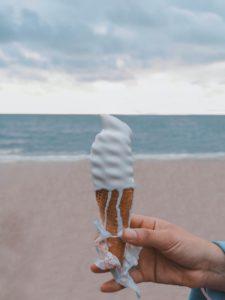 person holding vanilla ice cream on cone
