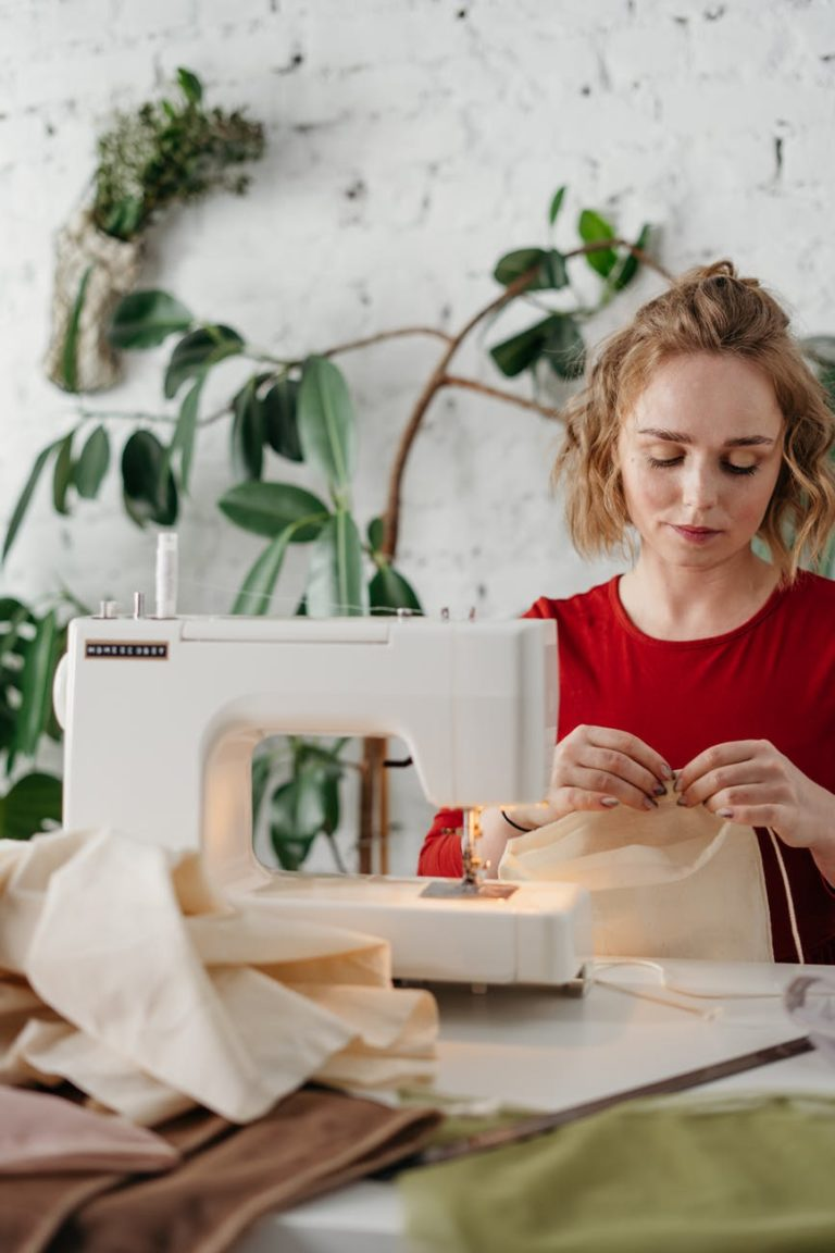 woman sewing a fabric